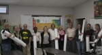 Teachers in Livermore with the donated periodic table posters from Sandia National Laboratories.