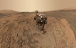"This self-portrait of NASA's Curiosity Mars rover shows the vehicle at the ""Mojave"" site on Mount Sharp, combining dozens of images taken in January 2015. The circle visible at the top of the rover's mast is part of the ChemCam instrument developed in part by Los Alamos National Laboratory. 