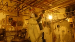 Employees in the Americium Recovery Facility remove piping.