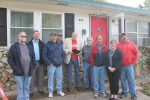 West Plains, Missouri, Mayor Jack Pahlmann issued a proclamation recognizing National Weatherization Day on Oct. 30.  Here, the Mayor (in sport coat and red shirt) presents his proclamation at a West Plains home undergoing weatherization. Weatherization funding for the home comes, in part, from the U.S. Department of Energy.