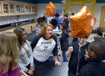 SRNS engineer Missy Byrne, center, works with middle school students at a teach-in at Davidson Fine Arts in Augusta, Ga.