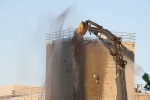 High-reach shears begin removing the top floor of the Plutonium Reclamation Facility.