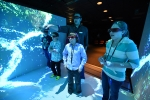 Students explore the inside of Idaho National Laboratory's Computer Assisted Virtual Environment.