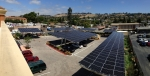 Pictured above is De-Meter's inaugural project for Tiburcio Vasquez Health Center, a 200kW combination rooftop and carport distributed generation installation in San Leandro, CA. Photo courtesy of De-Meter.