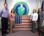 Pictured from left to right in front of the Paducah site's American Flag display are Mark Duff (LATA Environmental Services of Kentucky, LLC), Christa Dailey (Pro2Serve), Jennifer Woodard (EM Site Lead), and Kelly Layne (LATA KY).