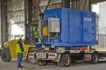 Fluor maintenance mechanic Robert Fulton lifts equipment at the C-337 former uranium enrichment process building at EM's Paducah Site.