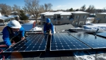The updated Database of State Incentives for Renewables & Efficiency helps homeowners and businesses find incentive programs that can reduce or defray installation or purchase costs of technologies like photovoltaic systems. | Photo by Dennis Schroeder, National Renewable Energy Laboratory