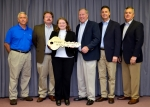 EM Paducah site lead Jennifer Woodard accepts the symbolic key to the Paducah Gaseous Diffusion Plant, commemorating the return of the leased facilities from Centrus Energy Corp. to EM in a ceremony at the plant this morning. Also pictured are, back row, left to right, Fluor Federal Services Paducah Deactivation Project Operations Director Bob Nichols; EM Portsmouth/Paducah Project Office Deputy Manager Robert Edwards; Centrus Energy Paducah Government Services Director Mark Keef; Centrus Acting General Manager/Paducah Plant Manager Mike Buckner; and Centrus American Centrifuge Vice President Steve Penrod.