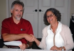 To foster continued teamwork to complete cleanup work safely, under budget, and ahead of schedule, UCOR and DOE renewed their partnering agreement that lays out the framework for future collaboration. Ken Rueter, UCOR President and Project Manager, and Sue Cange, Acting Manager for DOE's Oak Ridge Office of Environmental Management are pictured at the signing ceremony.