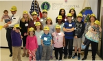 """Team Parent recently hosted the EM portion of DOE's """"Take Your Daughter or Son to Work Day."""" Family members of EM employees are pictured with EM Assistant Secretary Monica Regalbuto, far right, and EM Principal Deputy Assistant Secretary Mark Whitney, far left."""