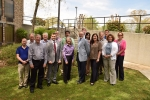 Senior officials from DOE's Oak Ridge Office of Environmental Management and North Wind Solutions celebrate the one-year anniversary of signing a partnering agreement. Linda Beach is pictured in the center of the group.