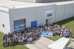 DOE and Parsons employees gather in front of SWPF after the ribbon-cutting ceremony.