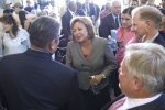 New Mexico Governor Susana Martinez greets Terry Aguilar, governor of San Ildefonso Pueblo, while Frank Marcinowski (lower right), EM deputy assistant secretary of waste management, and Dan Cox, LANL associate deputy director for environmental affairs, look on.