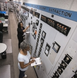 H Canyon Senior Control Room Operators Deborah Thomas (top) and Audrey Davis prepare for the startup of the First Cycle unit operations, marking the first time this operation has ran in more than five years.