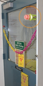 E-flares, shown in the circle, are used in HB Line areas to help alert personnel of radioactivity levels and personal protective equipment requirements.
