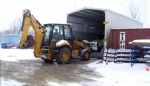 A Swift & Staley heavy equipment operator moves salt.