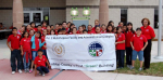 Fifth graders from Pharr-San Juan-Alamo Independent School District's North Alamo Elementary celebrate the opening of the new Precinct 2 Multi-Purpose Facility and Administration Complex in Hidalgo County, TX. The students received tours of the facility and heard presentations from vendors and other green organizations in the Rio Grande Valley on energy efficiency ideas for the home, recycling, energy production and consumption, wind and solar power and groundwater runoff.