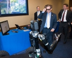 """Rep. Chuck Fleischmann (R.-Tenn.), chairman of the House Nuclear Cleanup Caucus, dons 3-D glasses while interacting with """"Robo Sally"""" at the Sept. 14 event for the caucus on Capitol Hill that focused on the EM Science of Safety Initiative. Robo Sally is an advanced robot developed by the Johns Hopkins University Applied Physics Laboratory."""