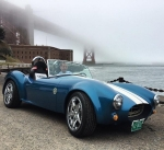 AMO Deputy Director Rob Ivester drives a 3-D printed Shelby Cobra near the Golden Gate Bridge during the seventh Clean Energy Ministerial.