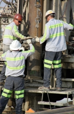 A team of drillers installs a well to support groundwater treatment operations at the Hanford site.