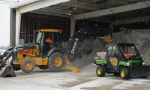 A Swift & Staley heavy equipment operator loads a salt spreader at Paducah's C-732 Salt Storage Facility.