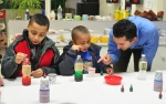 Michael Rigas, a civil engineer with OREM, teaches students at Woodland Elementary how to make lava lamps.