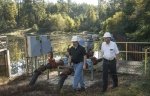SRNS engineers George Blount and Jeff Thibault inspect equipment used to remove low-level groundwater contamination.