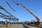 Construction workers build the frame for a 1-megawatt solar microgrid project at Fort Hunter Liggett, California. | <em>Photo courtesy of U.S. Army/Carlos J. Lazo</em>