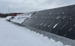 At the Regional Test Center in Williston, Vermont, researchers are examining how framed (in the background) and frameless (in the foreground) solar photovoltaic modules handle snowy conditions. | Photo Courtesy: Sandia National Laboratories