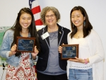 Sue Cange (Center), Manager for DOE's Oak Ridge Office of Environmental Management, presented plaques to student representatives Sophi Cui (Left) and Alana Joldersma (Right) at ORSSAB's May 11, 2016, meeting.