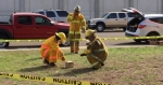 Emergency responders search for a mock radiological source in a training exercise.