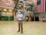 Dan Wachs stands in front of TREAT test reactor.
