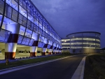 A commercial building that is lit up with LED lighting.