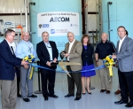 Officials mark the completion of construction of the Engineered Scale Test Facility during a ribbon-cutting ceremony July 20.