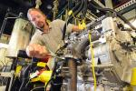 """Argonne mechanical engineer Thomas Wallner adjusts Argonne's """"omnivorous engine,"""" an automobile engine that Wallner and his colleagues have tailored to efficiently run on blends of gasoline, ethanol and butanol. 