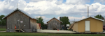 The US Army Corps of Engineers Hut test site in Champaign, IL. ORNL used EnergyPlus to model the performance of the original B-Hut (middle), insulated B-Hut (left) and SIP Hut (right).<br />Credit: Oak Ridge National Laboratory.