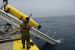 An unmanned undersea vehicle (UUV) being deployed during a U.S. Office of Naval Research demonstration near Panama City. Solid oxide fuel cell technology being developed by the Office of Fossil Energy for coal-fueled central power generation is being adapted to power UUVs. U.S. Navy photo by Mr. John F. Williams/Released.