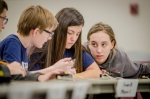 Pictured left to right: Calloway County Middle School students Isaac Martin, Drake Calhoon and Emma Arnett work together to answer questions during the final match of the DOE Regional Science Bowl.