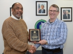 Richard Mayer, right, is pictured with Portsmouth Site Director Dr. Vincent Adams with a plaque commemorating Mayer's accomplishment.
