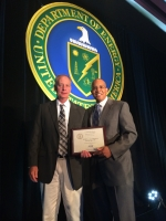 Damon Detillion, Project Manager for Wastren-EnergX Mission Support, Accepts 8(a)/Small Disadvantaged Business of the Year Award from OSDBU Director John Hale, June 12, 2014, Tampa, FL