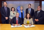 Officials with EM and NSF are pictured. Standing, left to right: Jeff Trinkle, NSF Program Director, NRI, and Robust Intelligence Information and Intelligent Systems Division; Lynne Parker, NSF Program Manager, NRI; Fay Cook, NSF Assistant Director, Social, Behavioral, and Economic Sciences; EM Principal Deputy Assistant Secretary Mark Whitney; and EM Senior Technical Advisor Rodrigo Rimando. Seated, left to right: James Kurose, NSF Assistant Director, Computer and Information Science and Engineering; and EM Assistant Secretary Monica Regalbuto.