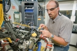 Argonne engineer Steve Ciatti works on an engine in Argonne's Engine Research Facility -- a facility where researchers can study in-cylinder combustion and emissions under realistic operating conditions. | Photo courtesy of Argonne National Laboratory.