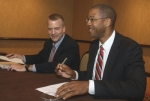 Acting ASFE, Christopher Smith, and Alaska Department of Natural Resources Commissioner, Dan Sullivan, sign an MOU at the LNG 17 Global Conference in Houston, Texas, pledging to work together in the effort to get more of Alaska's fossil fuels into the energy stream. Photo courtesy of LNG 17.