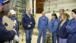 CWI employees discuss safety procedures before they remove a spent nuclear fuel shipment from a shipping container.