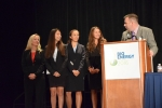 """2016 BioenergizeME Infographic Challenge Winning Team: (From left to right) Maria Zeitlin (advisor), Lexington Zografakis, Sydney Bracht, and Sidney Davis were recognized by Jonathan Male, Director of the Bioenergy Technologies Office. The team and their advisor from Smithtown High School East in St. James, New York, were recognized at the Bioenergy 2016 conference for their winning infographic """"Cellulosic Ethanol: Fuel of the Future."""""""