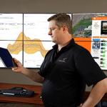 Researcher Matt Kosmos studies building efficiency data in PNNL's Building Operations Control Center. Photo courtesy of PNNL.