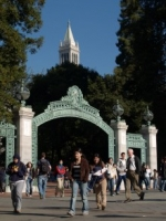 Photo of an archway entrance on the UC Berkeley campus, with students walking all around it and in front of it.