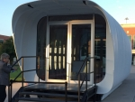 Photo of the front of the 3D-printed house.