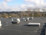 Rooftop of a commercial building with heating, ventilation, air conditioning and refrigeration units.