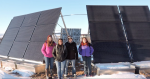 Students pose in front of Buckland's 10.53-kW solar system used to power the village's new water plant. Photo from Alison Jech, Buckland School.